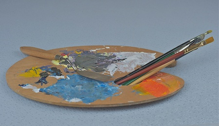 Painter palette with brushes. Stock Photo - 12047152