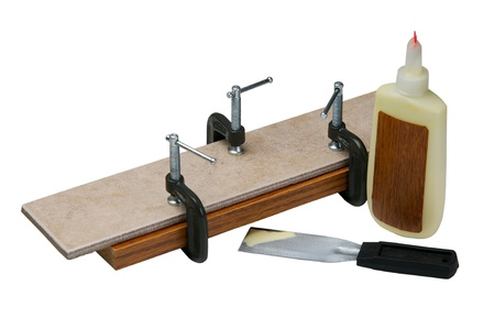 Adjusting clamps on wood and ceramic isolated on a white background. photo
