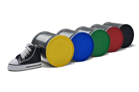 Five color cans and beside a gumshoes isolated on a white background. Stock Photo - 13082975