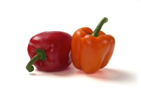 Two fresh sweet red pepper  on a white background. photo
