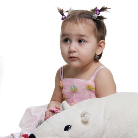 The small beautiful girl with toy white bear isolated against white  Stock Photo - 13265131