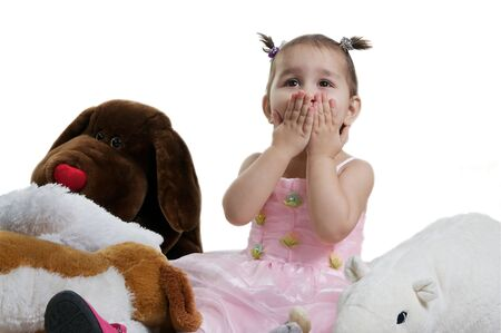 Beautiful and smilling child with toy brown and white bears isolated against white Stock Photo - 13265024