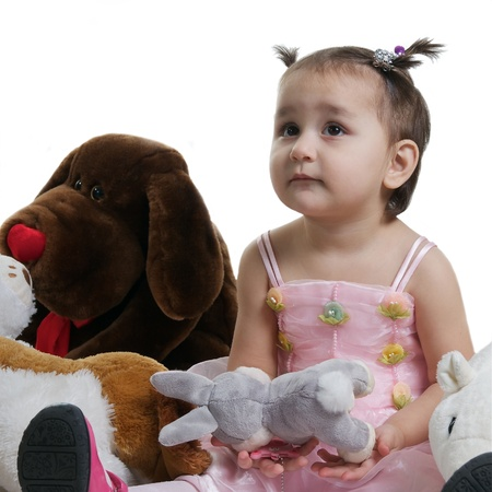 Beautiful and smilling child with toy brown and white bears isolated against white  photo