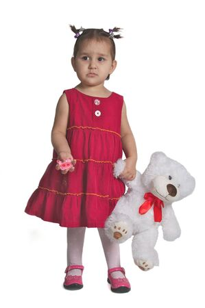 The small beautiful girl with toy white bear isolated against white  photo