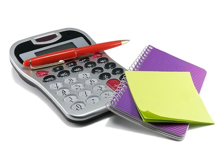 Calculator,a red pen and notebook on a white background. photo
