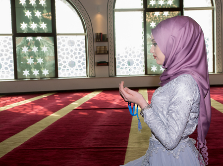 mistic: Young girl praying in mosque Stock Photo
