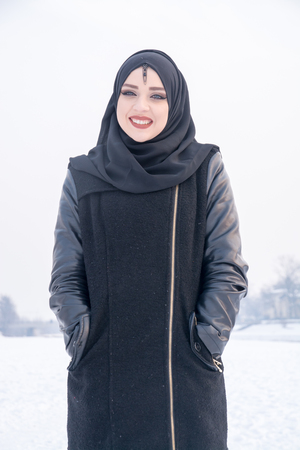 Young muslim girl with beautiful smile Stock Photo