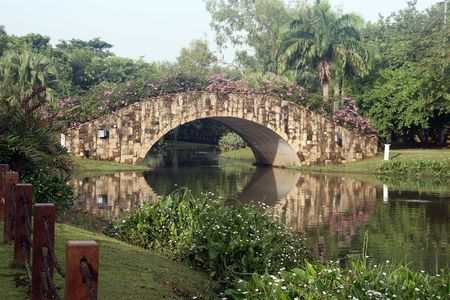 bridge over water: arch stone bridge over water