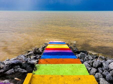 Colourful staircase into the sea