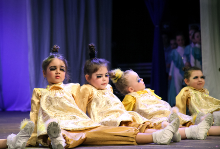 eyes opened: Little girls dancers are on stage, they opened their mouths and narrowed his eyes with big eyelashes. Childrens choreography, performance Editorial