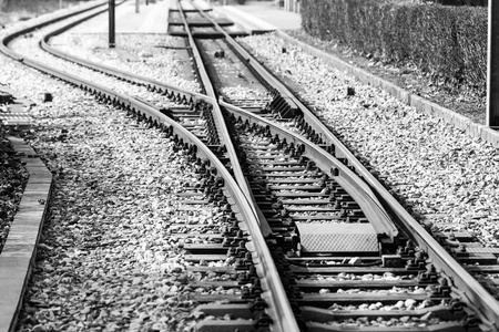 Train tracks and points in black and white. photo