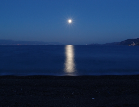 A romantic and magic moonlight in the sea of Corinth in Greece photo