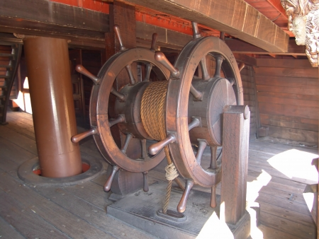Particular ship wheel of Neptune Galeon in the port of Genova italy photo