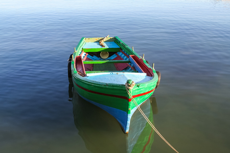 Typical fishing boat in a  port of Siracusa city in Italy photo