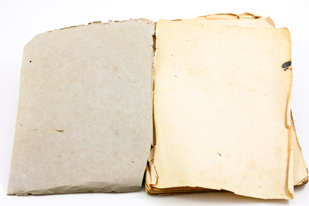 antiquarian: Blank pages of antiquarian book with parchment style pages; white background. Stock Photo