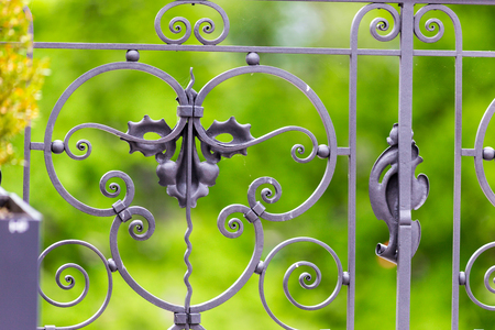 ironwork: Closeup of decorative metal design or ironwork on a fence or gate.
