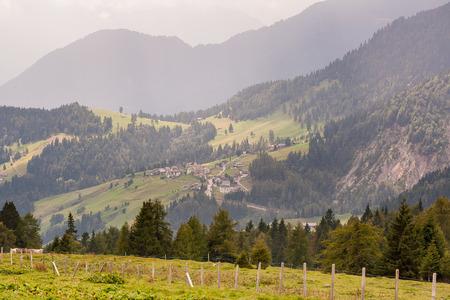 fenceline: Beautiful green mountainous landscape in Northern Italy.