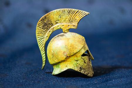 Ancient Greek helmet on a blue background photo
