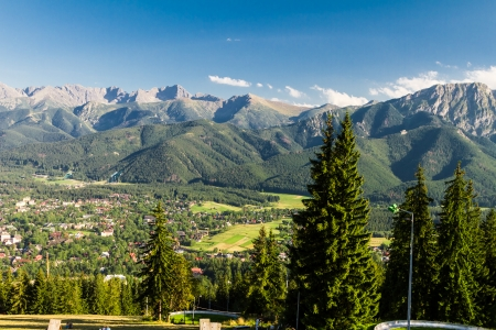 zakopane: Scenic iew of Tatra mountains with town of Zakopane in foreground, Poland. Stock Photo