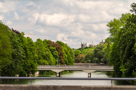 Scenic view of bridges over Isar river with city of Munich in background, Bavaria, Germany. photo