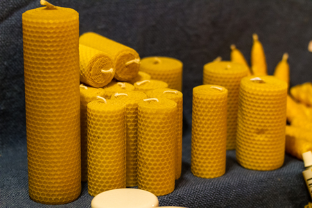 honeycombed: Details of a variety of natural, beeswax candles. Stock Photo