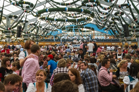 On the traditional Oktoberfest in Munich with thousands people drinkink good beer