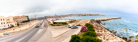 siracuse: Panoramic view of coastline and and cityscape in Syracuse or Siracuse, Italy. Stock Photo