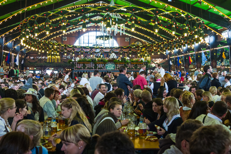 On the traditional Oktoberfest in Munich with thousands people drinking good beer