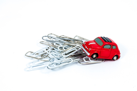 A miniature model 500 Fiat on paper clips. photo