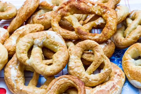 coarse: Handmade baked pretzels sprinkled with coarse salt. Stock Photo