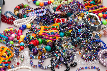 costume jewelry: Collection of colourful costume jewelry such as bracelets and necklaces made of glass and plastic beads. . Stock Photo