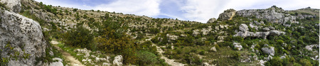 demos: A panoramic view of one of the most beautiful place in Sicily. the necropolis of Pantalica in Siracusa, natural reserve. Stock Photo