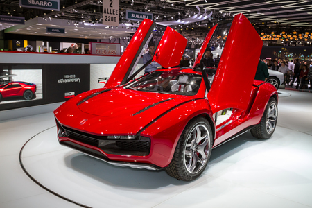 uplifting: Bright red Giugiaro Parcour coupe concept car with uplifting butterfly style doors at Geneva Car Show 2013.