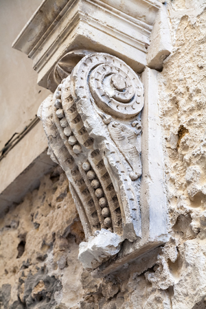 sconce: Close up of sconce on exterior of stone building. Stock Photo