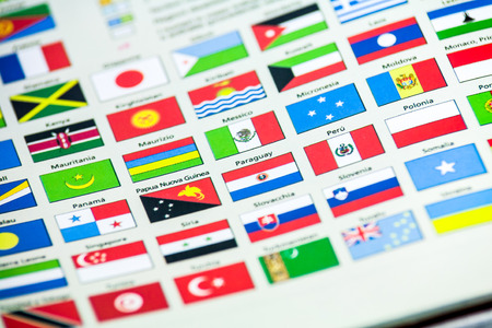 shallow: Colored chart of international national flags of different countries viewed at an oblique angle with shallow DOF