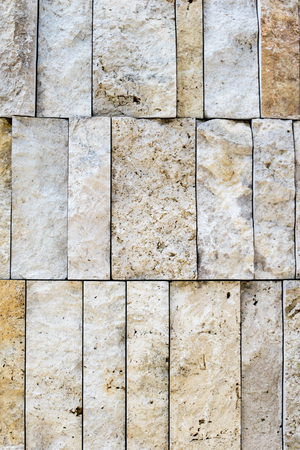 neatly stacked: Full frame of old vertical stone bricks neatly stacked closely together as background with copy space Stock Photo