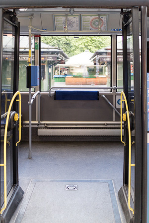 wheelchair access: Straight on view of wheelchair accessible open doors and yellow railing for empty train or tram in city Stock Photo