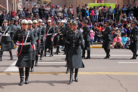 policewomen: Policewomen march on the main city square as they arrive at the parade on May 19, 2013 in Puno, Peru
