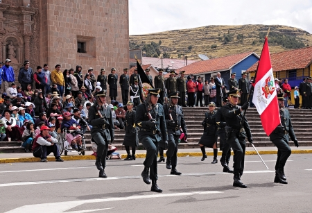 Military unit marches on the main city square as it arrives at the parade on May 19, 2013 in Puno, Peru  Editorial