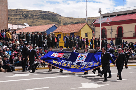 Officials go over the main city square as they arrive at the parade on May 19, 2013 in Puno, Peru