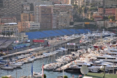 Preparation for the qualifying races of Formula 1 Grand Prix de Monaco finishes, fashionable yachts are in port Hercules on May 24, 2012, Monaco