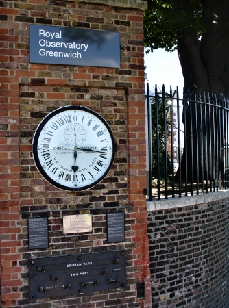 0 geography: Clock near prime meridian  Greenwich  England   Editorial