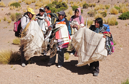Women-indians sell clothes and souvenirs during the train stop in Andes on April 27, 2013, Argentina  Altitude approx  is 4000 m above sea level