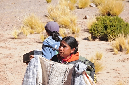 Woman-indian sells clothes during the train stop in Andes on April 27, 2013, Argentina  Altitude approx  is 4000 m above sea level  Stock Photo - 22905862