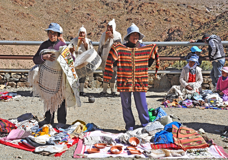 San Antonio de Los Cobres, Argentina  Indians sell clothes and souvenirs and play national music in Andes on April 27, 2013, Argentina  Altitude approx  is 4000 m above sea level