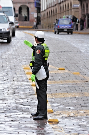 Policewoman stands on the street in the center of the city on May 18, 2013 in Cusco, Peru