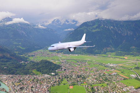 Passenger plane in the mountain valley