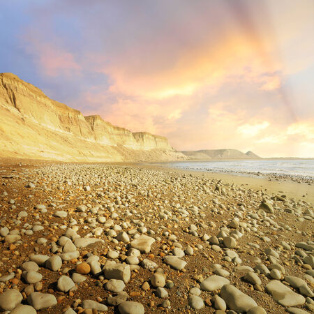 Low tide on the wild beach at sunset  Argentina  Stock Photo
