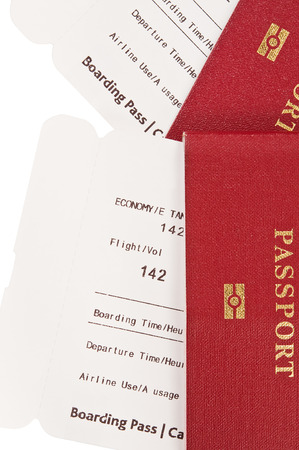 Two passports with airplane boarding passes inside  Stock Photo