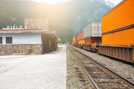 Freight train departs from Field station  Canadian rockies   photo